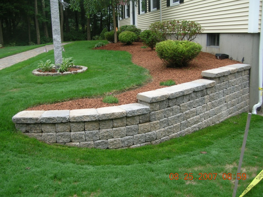 Your dream garden is never complete without landscaping for Rock wall garden designs