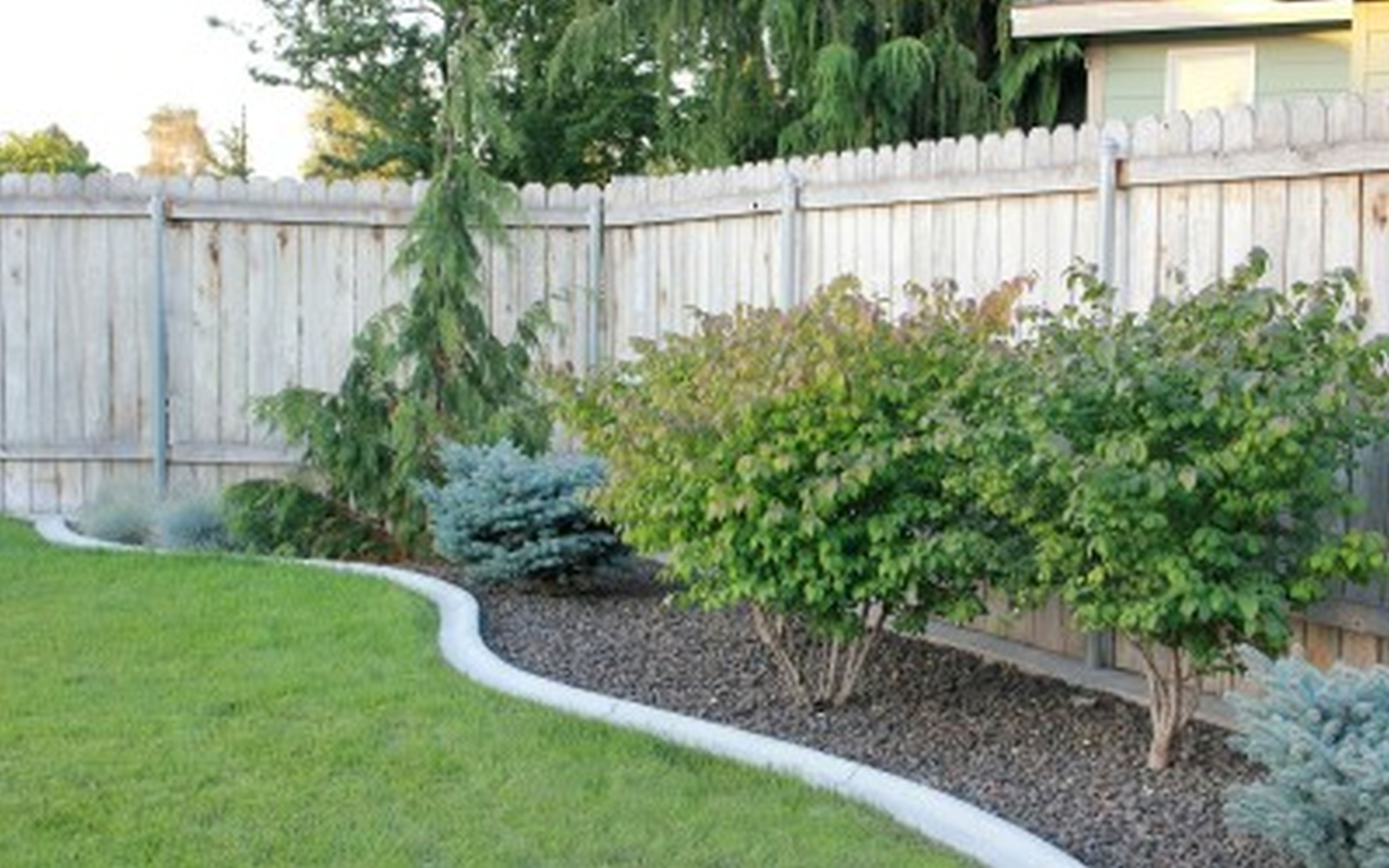 Backyard landscape designs on a budget large and for Patio landscaping