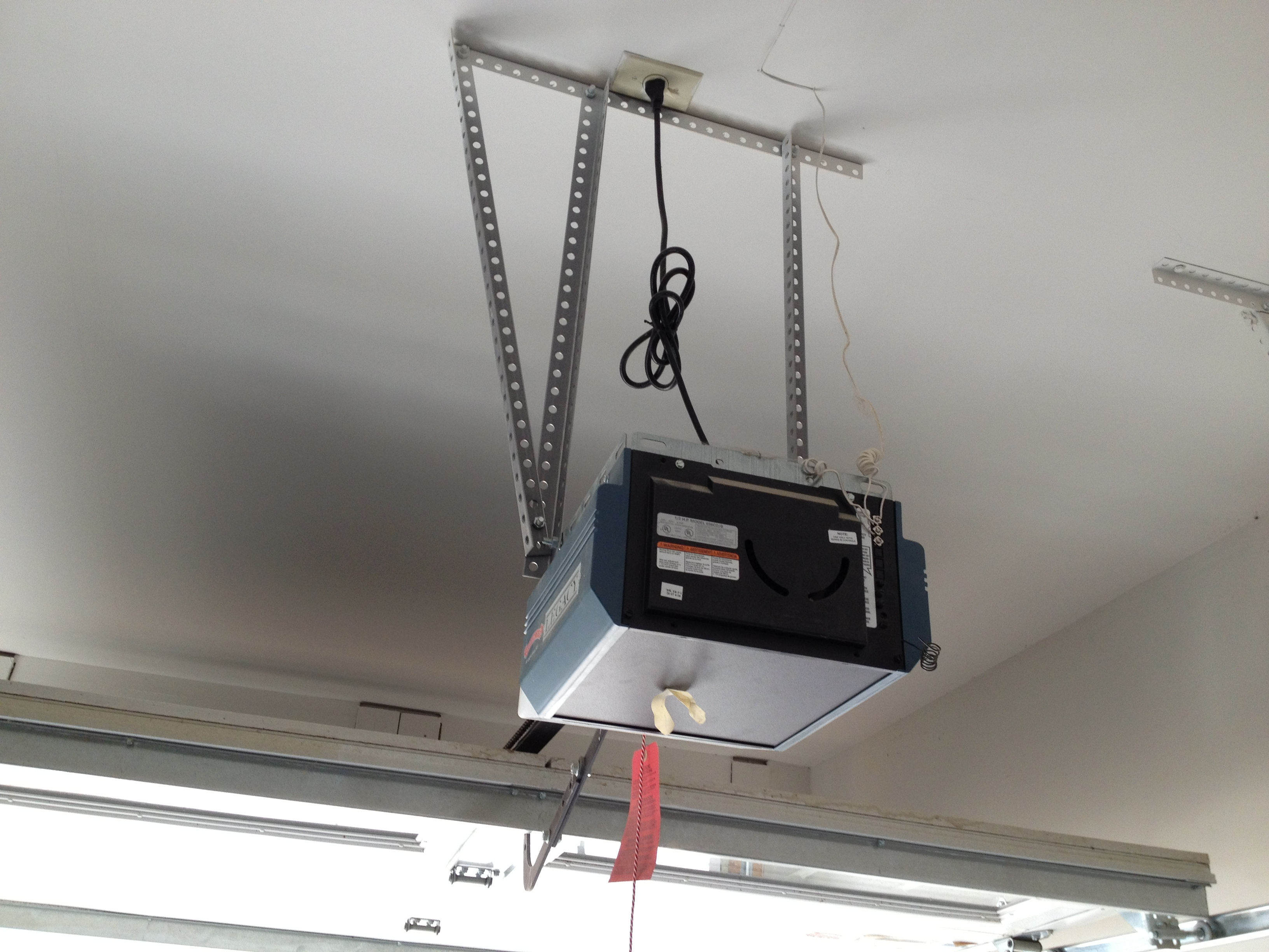 How hard is it to install a garage door opener large and for Selecting a garage door opener