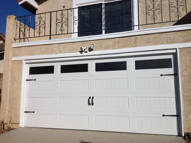 How to change a garage door Photo - 1