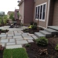 Backyard stone patio Photo - 1