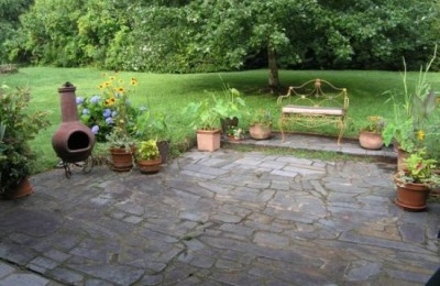 Stone backyard patio Photo - 1