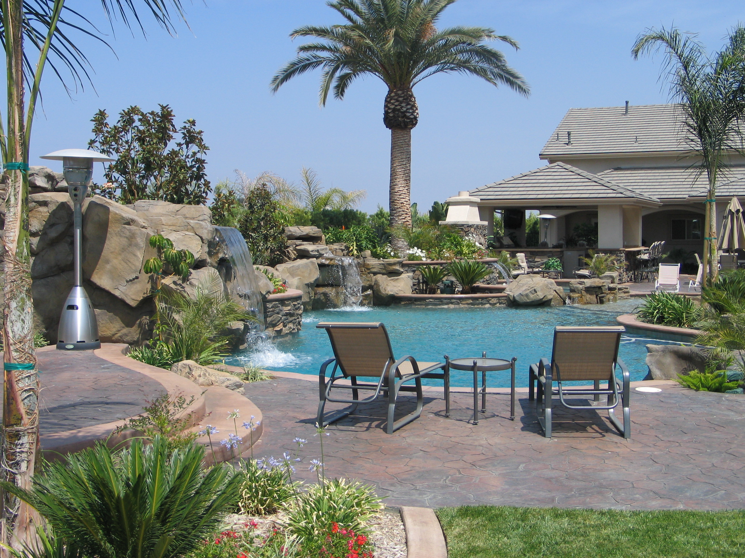 Amazing backyard pools large and beautiful photos photo for Pictures of backyard pools