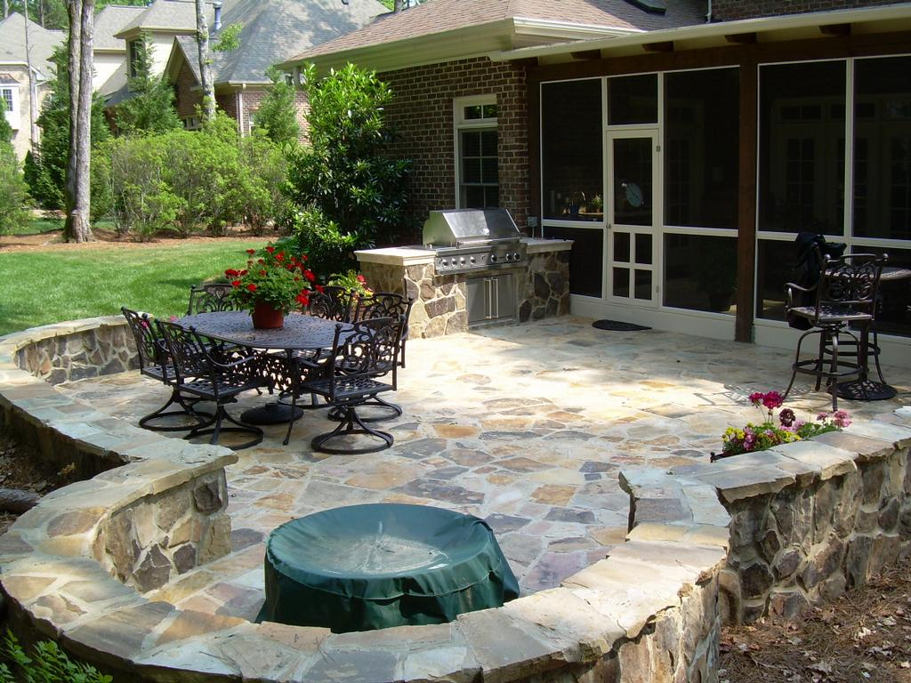 Backyard stone patio design ideas large and beautiful for The garden design team newark