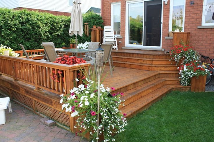 deck and patio ideas designs this uniquely shaped floating deck is large enough to support multiple - Patio Ideas For Small Yards