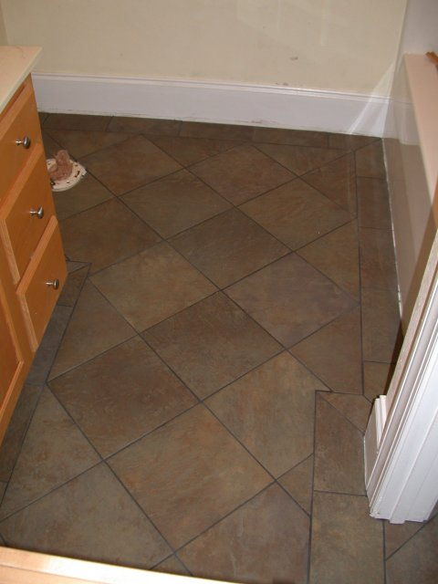 how to lay tile in bathroom floor photo - 1