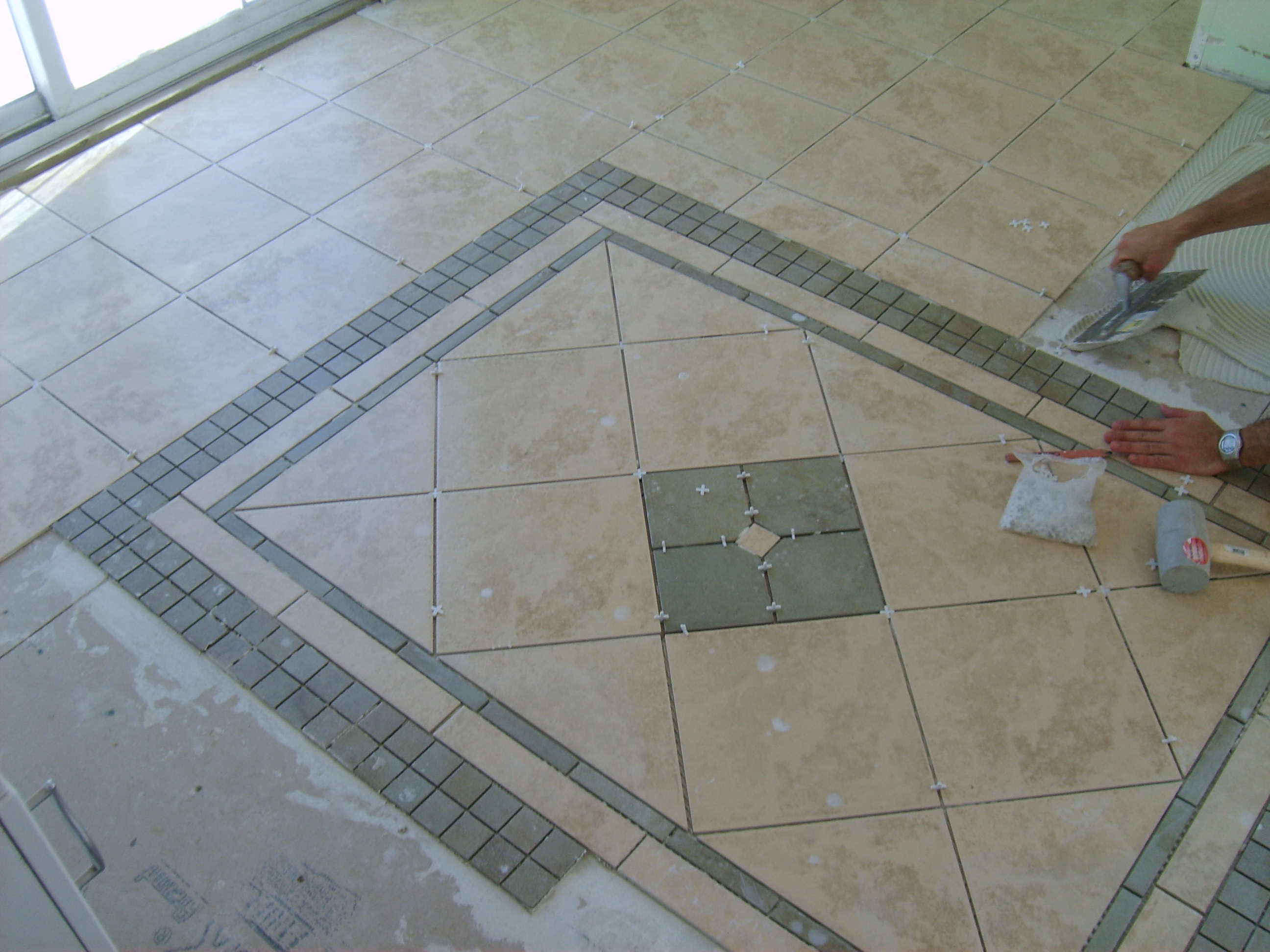 installing bathroom floor tile photo - 1