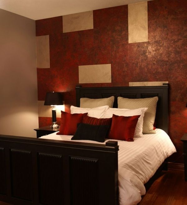 red accent wall bedroom photo - 2