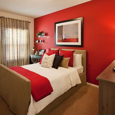 Red accent wall in bedroom